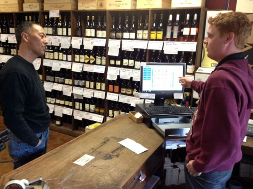 Kato traditionally has staffed his wine shop with Fresno State enology students, including senior Kerry Fitzgerald, right.
