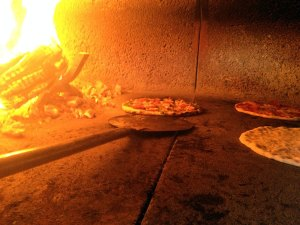 The wood stone floor is kept at 750 degrees. The beauty of a wood-fired oven at that the temperature ensures the crust will not be soggy and the radiated heat cooks the top ingredients quickly.