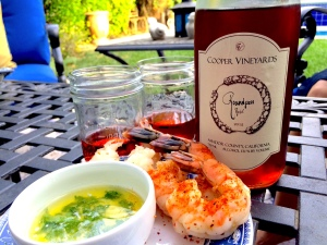 Tonight's meal began with seasoned jumbo shrimp dipped in butter and parsley. Geena and I each had a small pour of Cooper Vineyards 2012 Roundpen Rosé, Amador County.